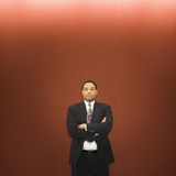 African American businessman standing with arms crossed