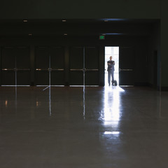 Caucasian businessman standing in doorway of empty room