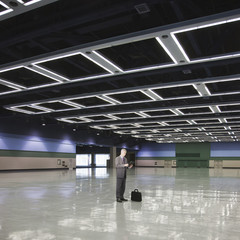 Caucasian businessman standing in empty room