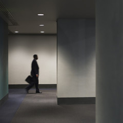 African American businessman walking in office corridor