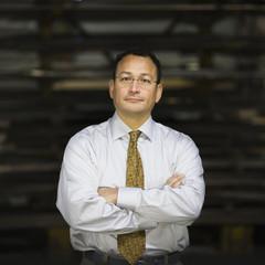 Serious Hispanic foreman in factory