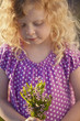 Caucasian girl picking flowers