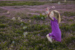 Caucasian girls chasing bubbles in field of flowers