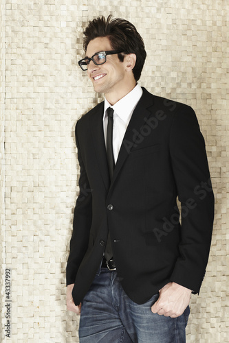 Trendy Caucasian businessman in fashionable eyeglasses