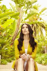 Caucasian woman sitting outdoors