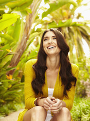 Smiling Caucasian woman sitting outdoors