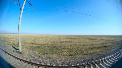 Steppe landscape through the window of a train. Fisheye lens.
