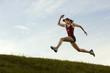 Caucasian runner running in field