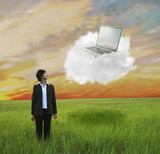 Kazakhstan businesswoman looking at laptop on cloud