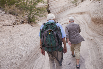 Senior Caucasian couple hiking together in canyon