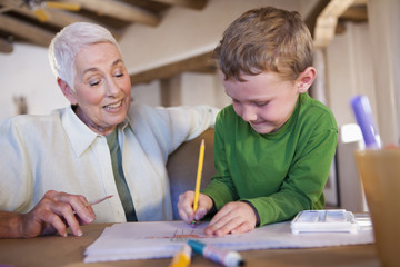 Caucasian grandmother and grandson drawing together