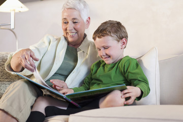 Caucasian grandmother reading to grandson
