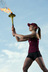 Caucasian athlete holding Olympic torch