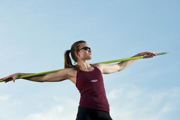 Caucasian athlete holding javelin