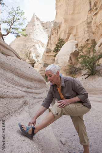 Senior Caucasian woman hiking in canyon