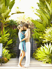 Caucasian couple hugging outdoors