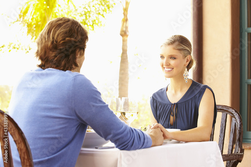 Glamorous Caucasian couple eating in restaurant