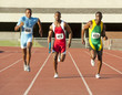 Runners running on track in relay race