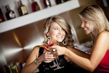 Hispanic friends toasting with martinis