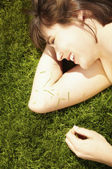 Caucasian teenager laying in grass