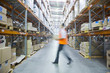 Manager walking in warehouse