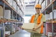 Worker holding box in warehouse