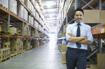 Manager standing in warehouse