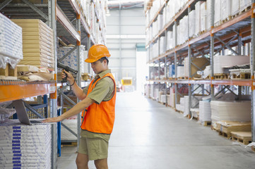 Worker scanning inventory in warehouse