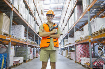 Worker standing with scanner in warehouse