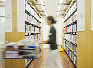 Hispanic woman working in library