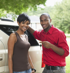 African American couple with new car