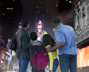 African American family enjoying urban city