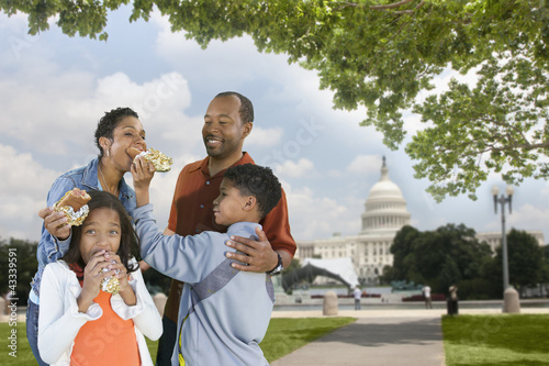 African American family eating hot dogs on vacation