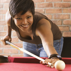African American woman playing pool