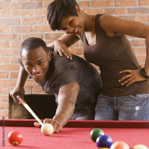 African American couple playing pool