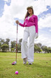 Hispanic woman playing golf