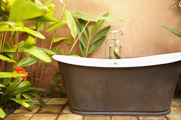 Old-fashioned bathtub outdoors