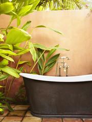 Old-fashioned bathtub outdoors