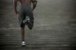 Black man running up stairs