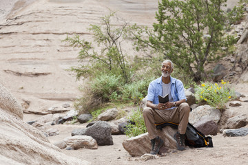 African American hiker taking a break in remote area