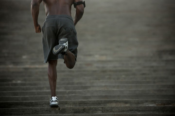 Black man running up stairs