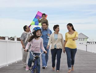Family walking on boardwalk together