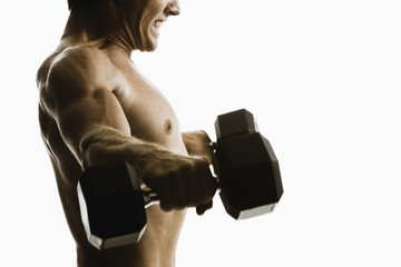 Caucasian man lifting weights