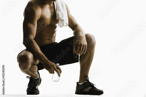 Caucasian man drinking water after exercise