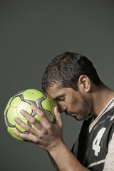 Serious athlete holding soccer ball