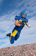 Caucasian football player catching ball