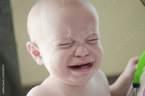 Crying mixed race baby in doctor's office