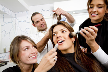 Hispanic woman having beauty treatments in salon