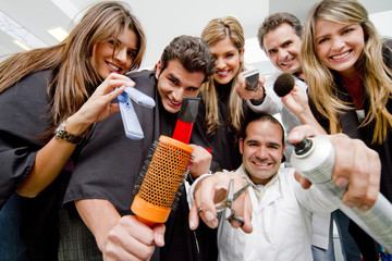 Hispanic clients and stylists in beauty salon