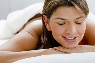 Hispanic woman laying on massage table